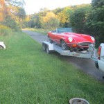 A red series 2 E-type arrives